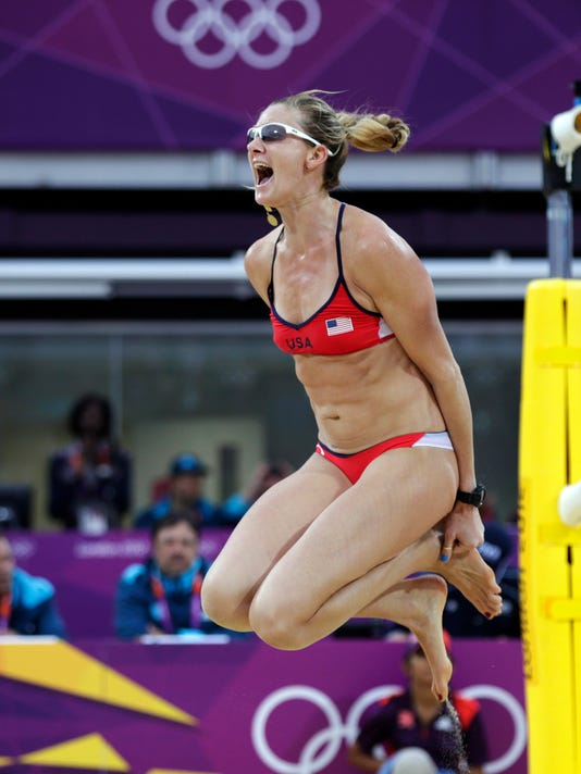 "FILE- In this Aug. 7, 2012, file photo, Kerri Walsh Jennings of the United States leaps in the air after beating China in two sets during a women's semi-final beach volleyball match at the 2012 Summer Olympics. A new film about the three-time Olympic gold medalist reveals her efforts to return to the Summer Games for a fifth time. Produced by Tribeca Digital Studios and Dick's Sporting Goods Films, ""Kerri Walsh Jennings: Gold Within"" will debut on July 31 on NBC. (AP Photo/Dave Martin, File)"