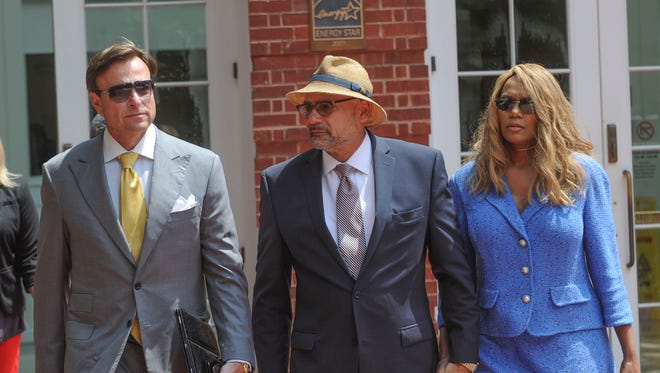 Joe Armstrong, center, with his wife, LeTonia, and attorney Gregory P. Isaacs, leaves court after being found guilty of one felony count in his tax fraud trial Aug. 8, 2016, at the Howard H. Baker Jr. U.S. Courthouse. The jury acquitted Armstrong of two other counts. He was charged with conspiring with accountant Charles Stivers to hide the profit from a cigarette tax stamp hike that Armstrong helped pass.
