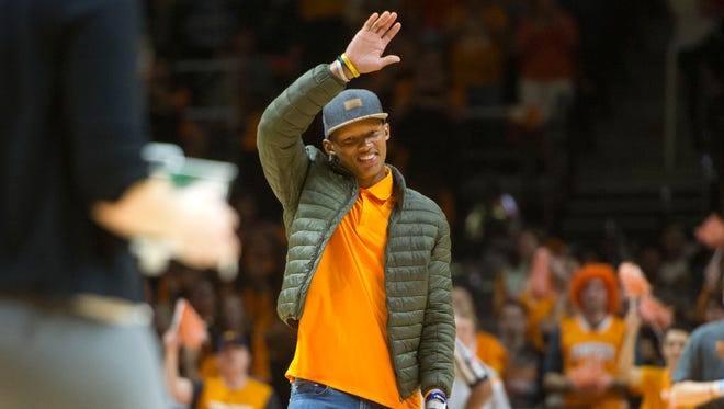 Tennessee quarterback Josh Dobbs walks onto the court during a game between Georgia and Tennessee in Thompson-Boling arena Thursday, Feb. 9, 2017.