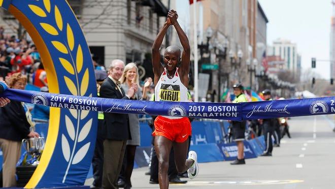 Geoffrey Kirui of Kenya hits the tape to win the men's division of the 2017 Boston Marathon.