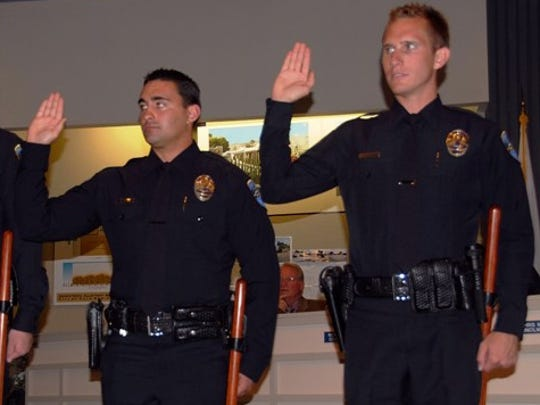 Palm Springs police officers Michael Heron, left, and Chad Nordman as they are sworn in during a City Council meeting. Photo courtesy Lee Husfeldt Palm Springs police officers (left to right) Michael Heron and Chad Nordman were sworn in Wednesday during the City Council meeting.