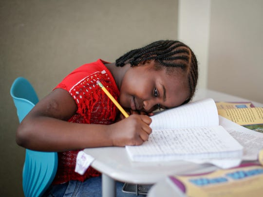Eman Muhamed, 10, studies during class at Carver Elementary