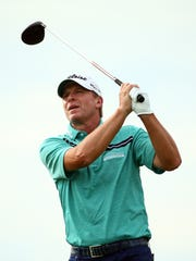 Steve Stricker plays his shot from the 10th tee during