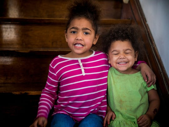Essence Bagley, 5, and her sister Tempest, 2, pose