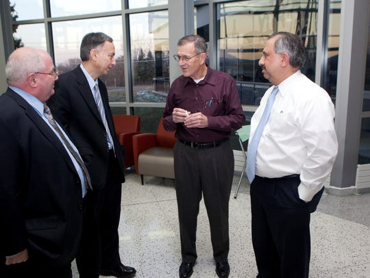 Harry Boyer (center) is the founder of Innovation Associates