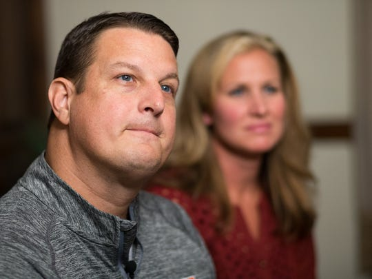 Kelly Wells, left, and his wife, Shawne, talk about the latest chapter in their lives.