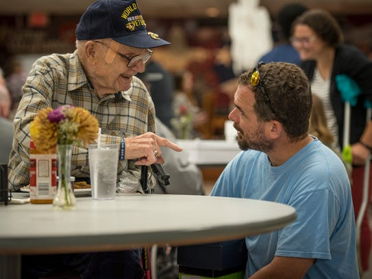 World War II veteran Curtis Spearman, 94, chats with