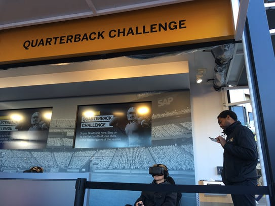 A football fan takes part in SAP's VR-based Quarterback