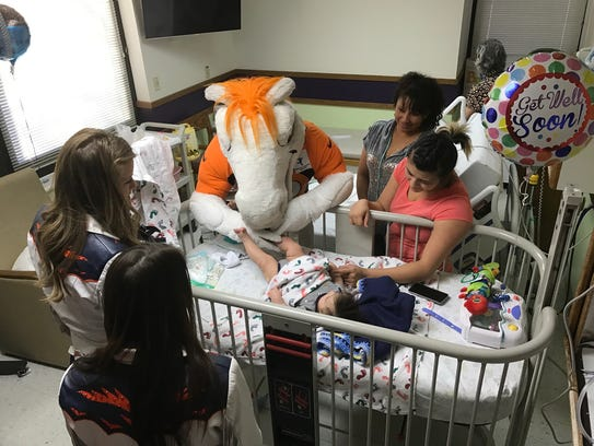 Miles and two Denver Broncos cheerleaders visit 3-month-old