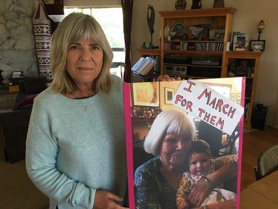 Sandy Bieler Rao of Camarillo displays the sign she