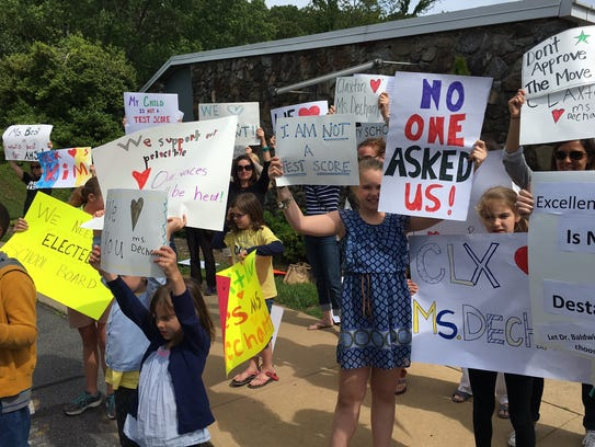 Students and parents protested outside a school board