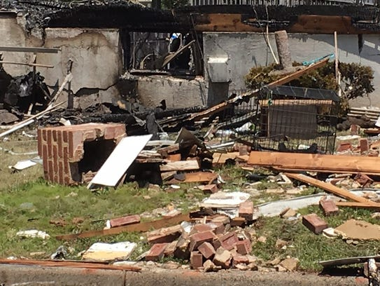 The remains of a chimney from a home that exploded
