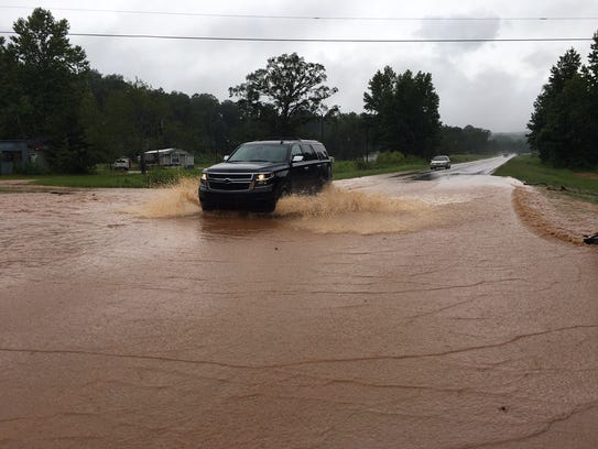 Water flooded portions of U.S. Highway 82 West in Prattville