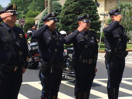Police salute Linden Officer Daniel Kuczynski.