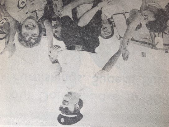 Fayetteville Fire Chief Jim Cutchall gets a victory ride in October 1975 after his firefighters win a pumping contest. Cutchall was killed by a shooter at a house fire on July 2, 1977.