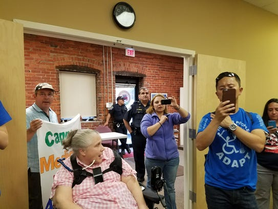 About 25 of the protesters from ADAPT Rochester were