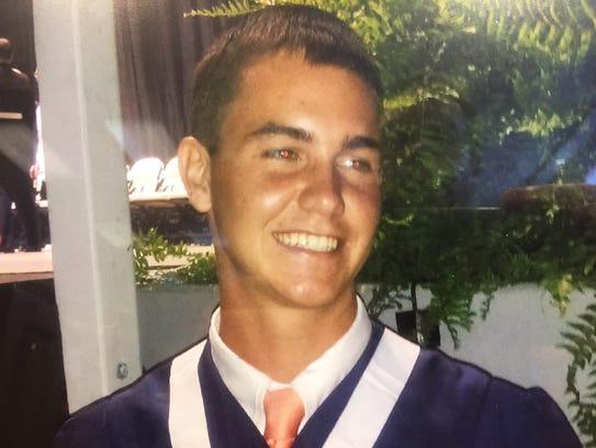 Photo of Remington Foradori at his graduation from