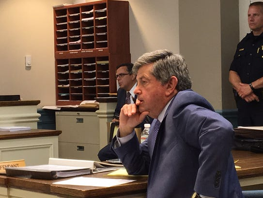 Attorney Larry Cohen listens to testimony during a