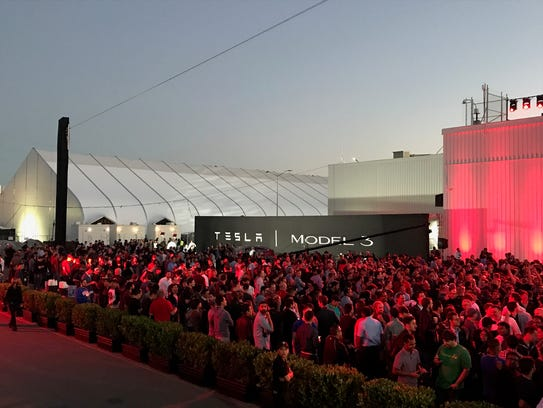 Hundreds gather outside of Tesla's Fremont, Calif.,