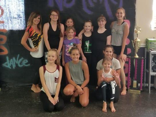 Dancers at No Limit Dance Studio pose with Mariah Heisler