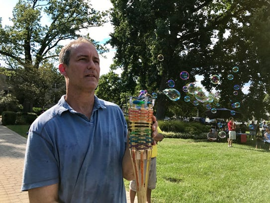 "Ed Scharf uses his ""bubble torch"" at a love rally at"