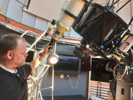 Mike Narock, Cranbrook astronomer, tunes up his 6-inch