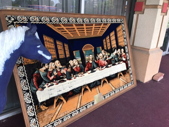 A framed tapestry of the Last Supper painting, on the