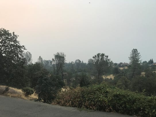 A heavy layer of smoke sits over northwest Redding