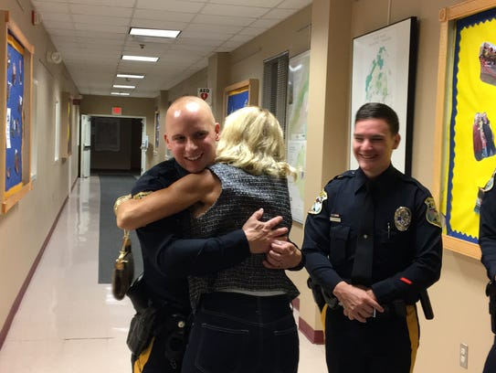 Tabatha Gennaro hugs Mount Olive Police Officer Rick