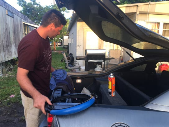 Marcos Perez packs his belongings Friday for a trip