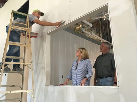Ronna and Brad Prickett oversee construction work at