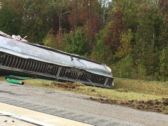 An overturned fuel tanker on Route 1 northbound, south