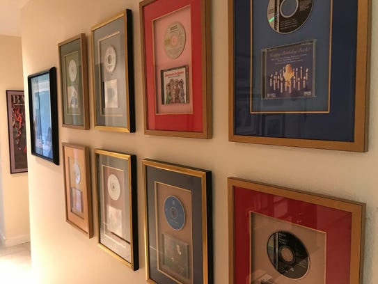 Framed CDs recorded by pianist/composer John Bayless