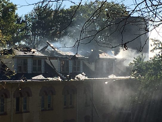 Smoke billows from the roof of the vacant Villia Maria