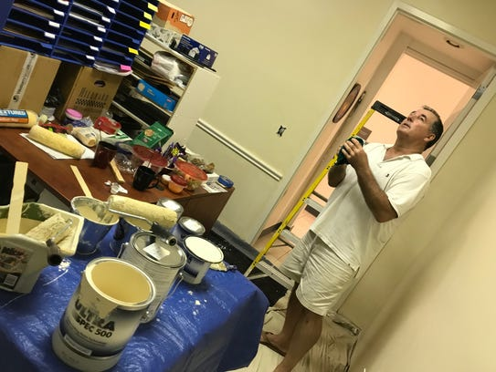 Ingmar Herrmann checks his work and the work of his team of volunteers who repainted the office of the Vero Beach Art Club on Oct. 14.