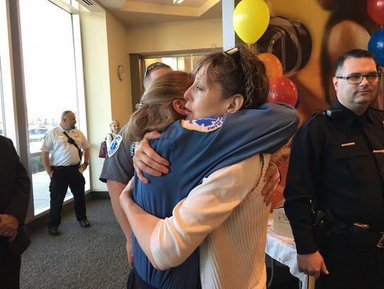 Nadine Roberts Szabo hugs Robert Wood Johnson University