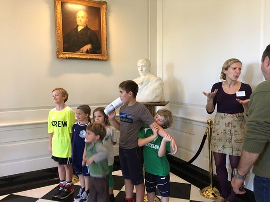 Children pose Oct. 21, 2017 in front of a bust of Napoleon