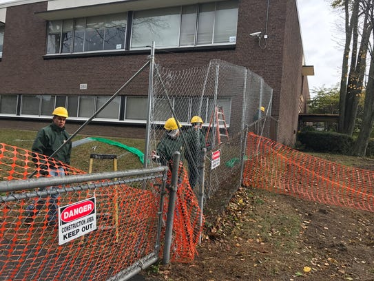 Construction workers investigate Port Chester Middle