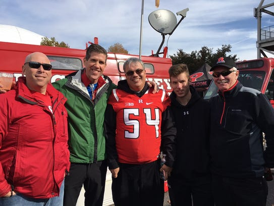 Philip Platek (second from left) and his friends tailgate