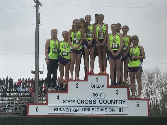 The Mount Gilead girls cross country stands on the