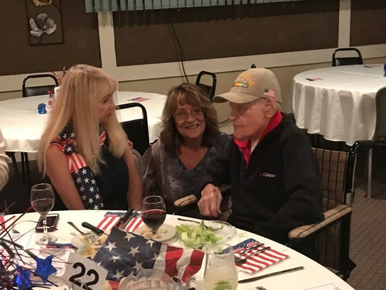 Portia DuMond, left, and Linda Elliott talk with 106-year-old