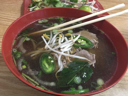 Beef pho with bean sprouts, jalapenos and basil from
