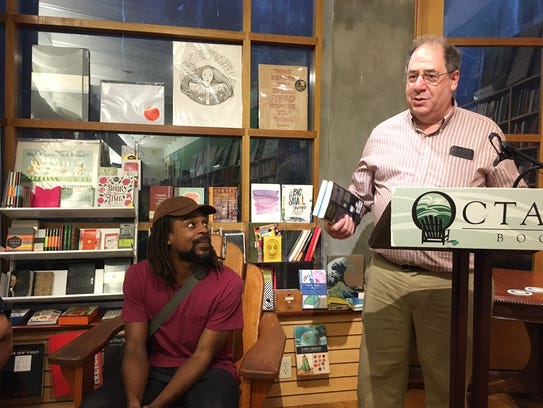 Octavia Books owner Tom Lowenberg (r) introduces author