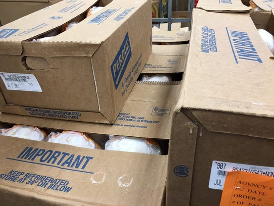 Boxes of chickens to be distributed to families at