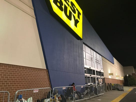 Future shoppers wait outside of Best Buy on Woodruff