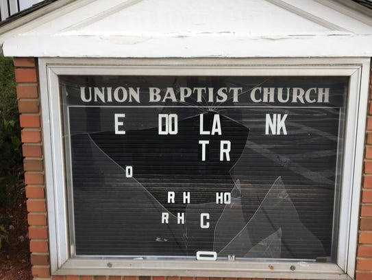 Vandals broke the glass sign outside Union Baptist