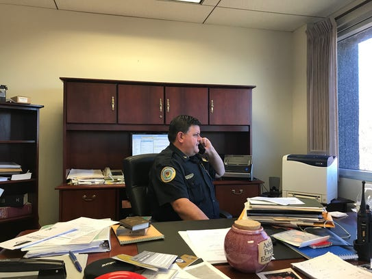 Chief Stauffer takes a phone call while cleaning out
