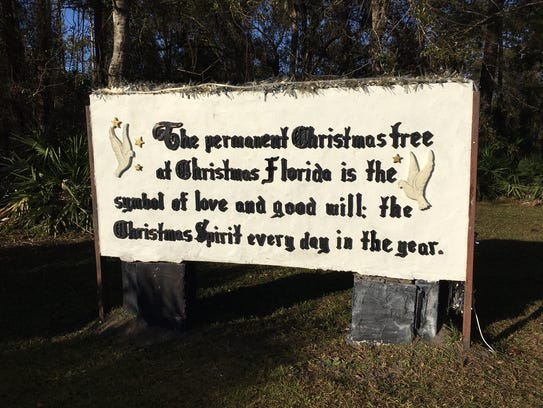 A sign shares the message behind the permanent Christmas