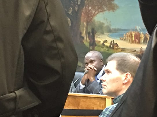 Plainfield Mayor Adrian Mapp looks at the line of residents