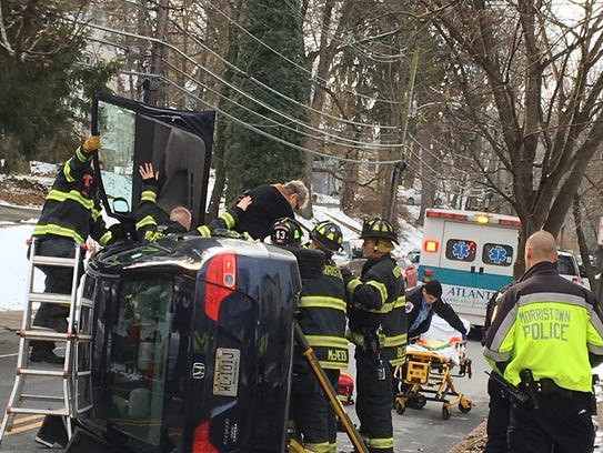 Morristown firefighters remove a female driver from